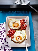 Fried eggs a la plancha with diced tomatoes
