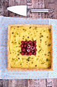 Olive oil, honey, lemon, raspberry and pistachio tart
