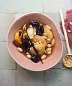 Spicy pear, almond, pine nut and prune sweet tajine