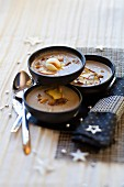 Cream of cep and chestnut soup with quails egg
