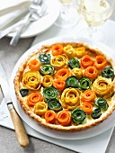 A colourful tart with vegetable flowers