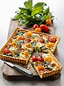 Savoury quiche with ricotta, spinach, cherry tomatoes and pine nuts