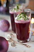 Red cabbage and apple gazpacho with salty whipped cream and fresh herbs