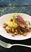 Duck Tournedos ,pan-fried mushrooms and mashed potatoes