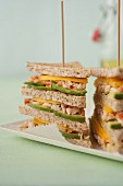 Crab,avocado and mango club sandwich