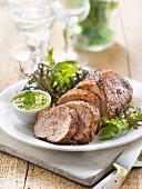 Marinated pork with coriander and yellow pepper pesto