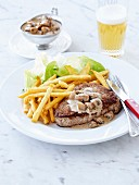 Steak and French fries,button mushroom sauce