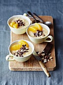 Orange cream dessert with dark chocolate flakes and hazelnuts