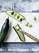 Using a melon baller to make cucumber balls