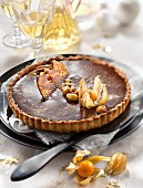Chocolate,salted-butter toffee and dried fruit tart