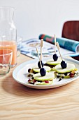 Apple, cream cheese, dried forest fruits and grapes on sticks