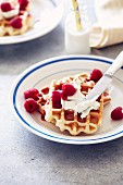 Waffle with cream cheese and raspberries