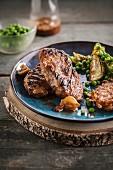 Grilled turkey steaks with rösti,peas and artichokes