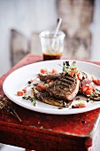 Marinated veal chop with thyme,tomatoes and eggplants