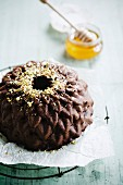 Chocolate and honey cake with crushed almonds