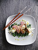 Veal with honey,sesame seeds,tender spinach and black radish
