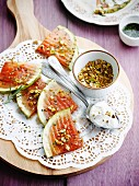 Grilled watermelon with crushed pistachios and whipped cream