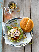 Vegetable burger with pine nuts and goat cheese