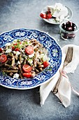 Pasta with tapenade (olive paste), feta cheese and cherry tomatoes