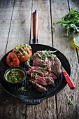 Steak with rocket pesto and stuffed tomato