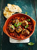 Meatballs in tomato sauce with basil