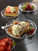 Wafles with whipped cream and strawberries