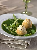 Watercress broth with green asparagus tops,rolled sole fillets in semolina crust
