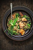 Soba noodles with greens, salmon marinated with soya sauce and honey
