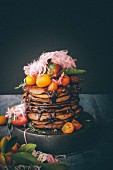 Pancakes with chocolate sauce and poached kumquats