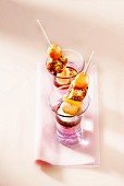Fresh fruit and caramelized cubes of fromage frais en brochette, scoop of ice cream