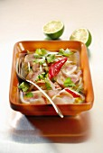 Pink seabream marinating with onions, chili peppers, lime and coriander