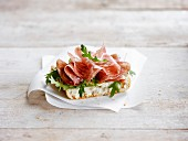 Cold cuts and rocket lettuce on sliced bread