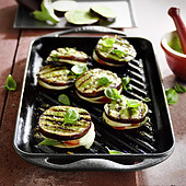 Grilled aubergine slices with pesto and mozzarella