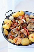 Clams with potatoes and confit tomatoes à la galicienne