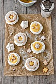 Lemon meringue tartlets in meringue nests