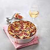 Gratin of figs with honey, glass of white wine