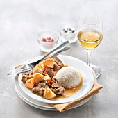 Sauté of lamb with quince and rice, glass of sweet white wine