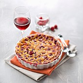Raspberry clafoutis, glass of red wine