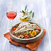 Tajine style sea bream, glass of Clairet rosé wine