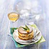 Mango and pineapple shortbread mille-feuille, glass of sweet white wine