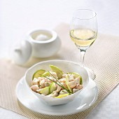 Sea bass tartar with Granny Smith apple, glass of fruity white wine