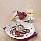 Beet Carpaccio with Black Radish, glass of white wine