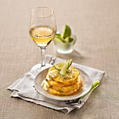 Roasted pineapple with hazelnut butter and thick lime cream, glass of sweet white wine
