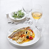 Grilled Mackerel with Fennel, Tomatoes and Olives, Orange Sauce, glass of sweet white wine