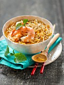 Spicy broth with noodles, shrimps, lemongrass, egg and nuoc-mâm sauce