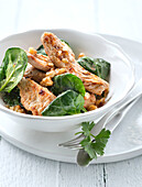Roast turkey fillets with spinach and walnuts