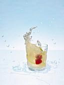 A glass of lemonade with fresh fruit