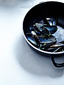 Empty mussel shells in a pot