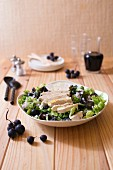 A salad of duck breast and black grapes