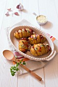 Roast hasselback potatoes with bacon